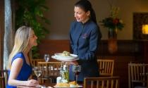 waitress-serving-guest-in-Brasserie-Restaurant-at-Clayton-Hotel-Dublin-Airport